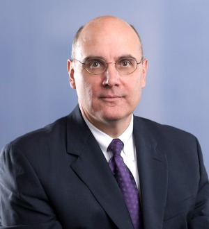Adrian E. Harless