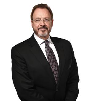 Mark G. Tratos